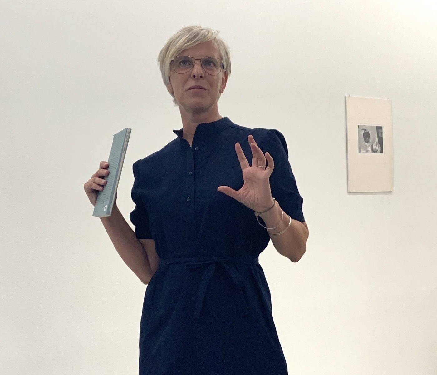 Jill Magi stands in a gallery space