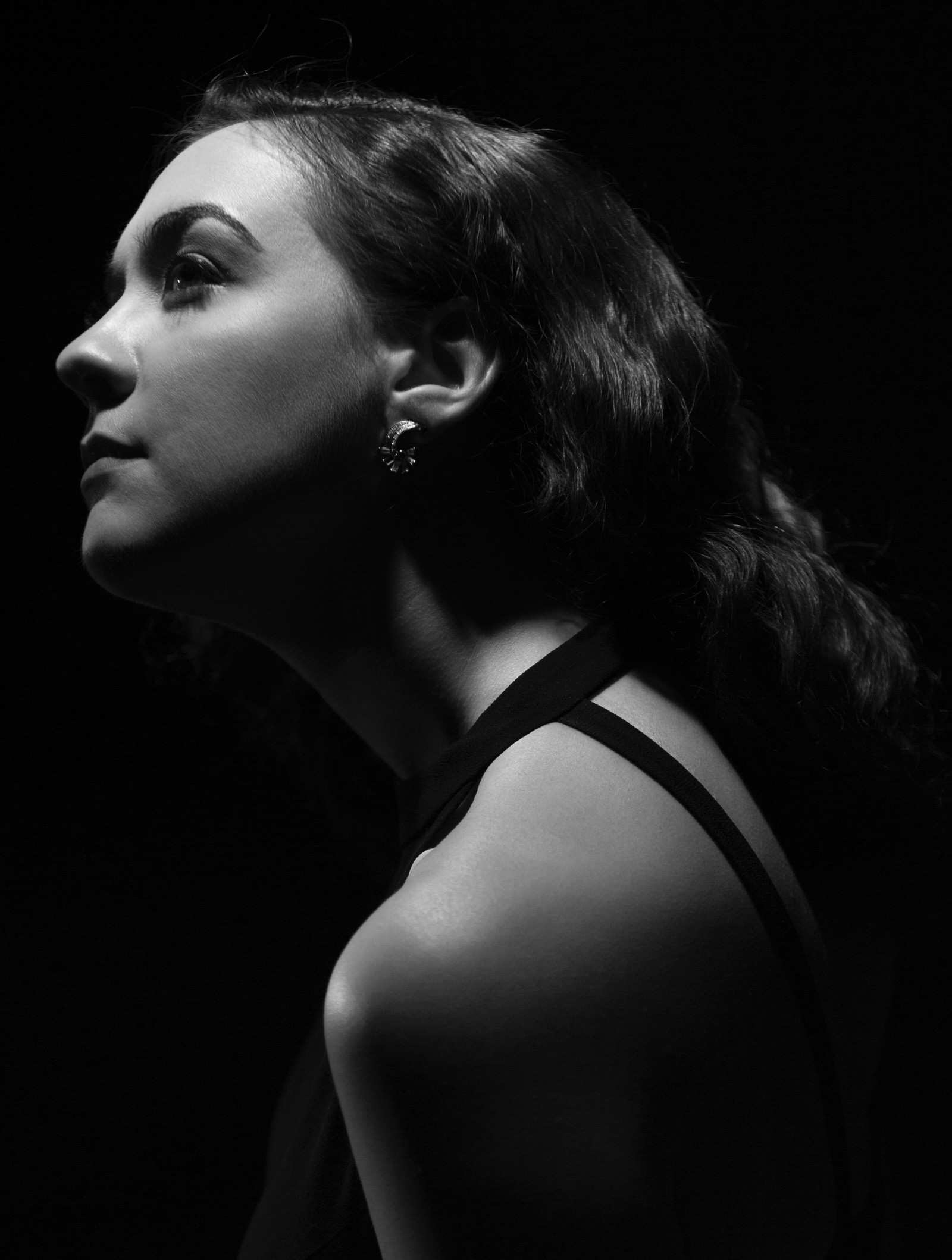 In this black and white portrait, Kathleen Granados is seen in profile, lit from above.